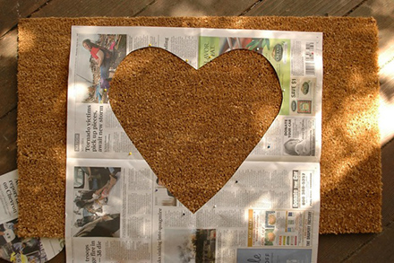 Image of a local newspaper with a large heart shape cut out of the center.