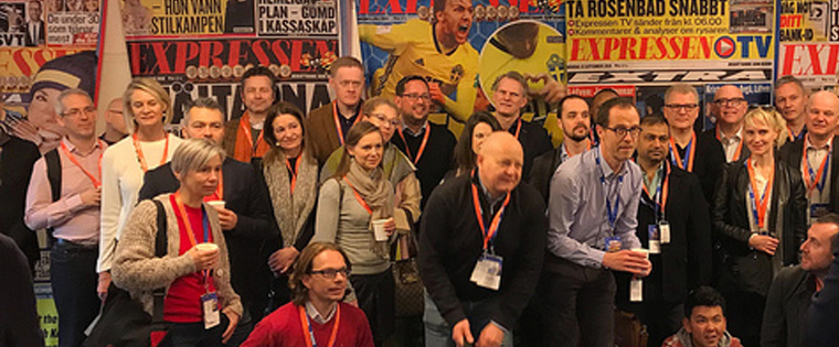 Study tour participants pose for a group photo at Expressen in Stockholm.