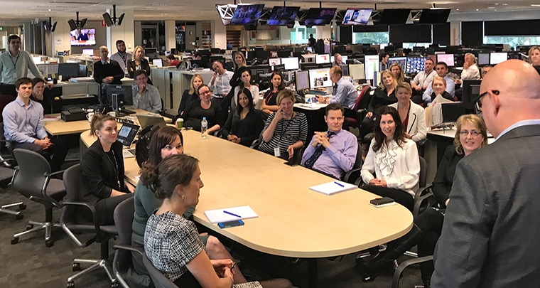 INMA's Earl Wilkinson addresses the newsroom at Seven West Media in Perth, Australia. Seven West Media houses newspaper, television, radio, and magazine brands in a single newsroom.