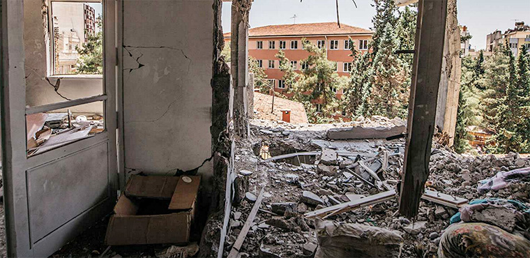 "The correspondents carry on their newspaper's tradition of ""listening to the people"" by reporting on the shelling of residential buildings in Kilis, Turkey."