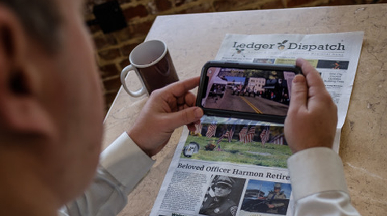 Ledger Dispatch readers can hold a smartphone over AR triggers throughout the print newspaper to launch multi-media content experiences.