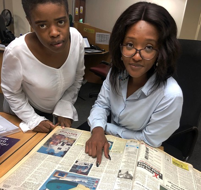 Staff participation was an important aspect of #PretoriaNews120. Here reporters Matlhatsi Dibakwane (left) and Goitsemang Tlhabye look at a back copy from 1994, the year Matlhatsi was born.