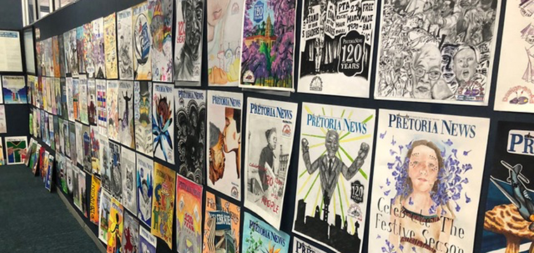 The Pretoria News #120 high school art project posters displayed for judging.