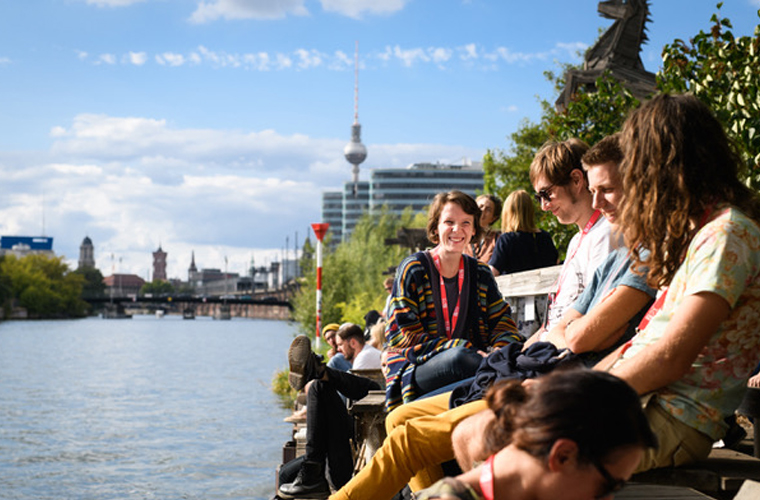 Z2X participants enjoy a break at the Spree in Berlin. Photo by Phil Dera.