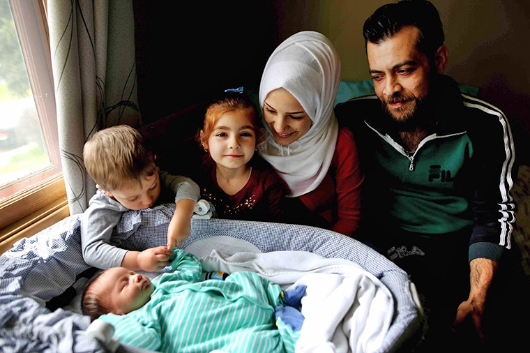 Afraa Bilan, 22, and her husband Muhammad Bilan, 29, came to Calgary in 2016 with two of their children, Nael, 3, and Naya, 5. Their third child was born May 4, 2016, in Calgary, and they named him Justin Trudeau Adam in honour of how Canada had welcomed them with open arms. Photo credit: Leah Hennel/Postmedia