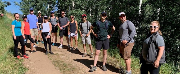 Participants at last week's Vail Roundtable take a break from hiking to admire the view.