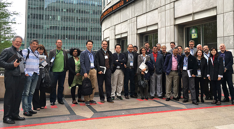 Study tour participants stand in front of Thomson Reuters.