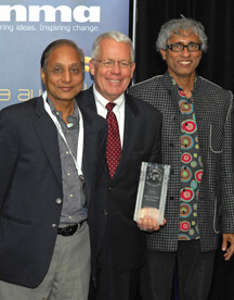 From left, Times of India CEO Ravi Dhariwal, INMA President Michael Phelps, and Times of India Executive President Bhaskar Das celebrate Bennett, Coleman & Company Ltd.'s achievements