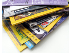 Stack of about ten magazines including National Geographic.