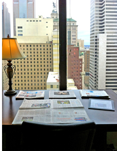 View of an office space looking out into city buildings.