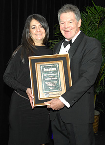 Yasmin Namini is presented INMA's Silver Shovel Award by Ross McPherson